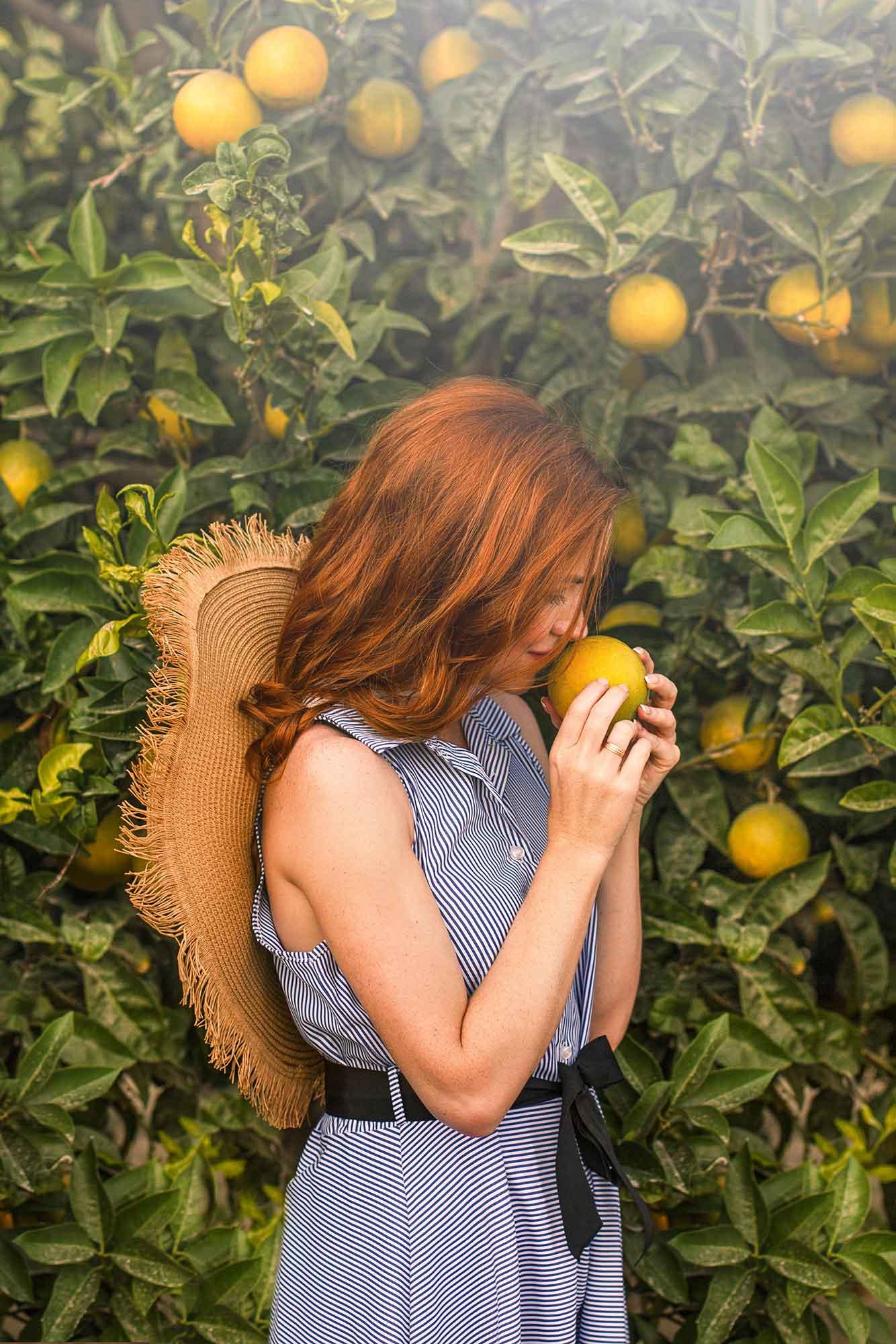Smelling citrus perfume