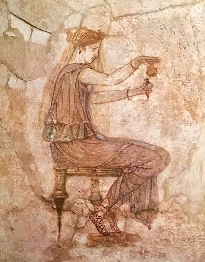 Affresco di donna con profumo a Villa Farnesina a Roma