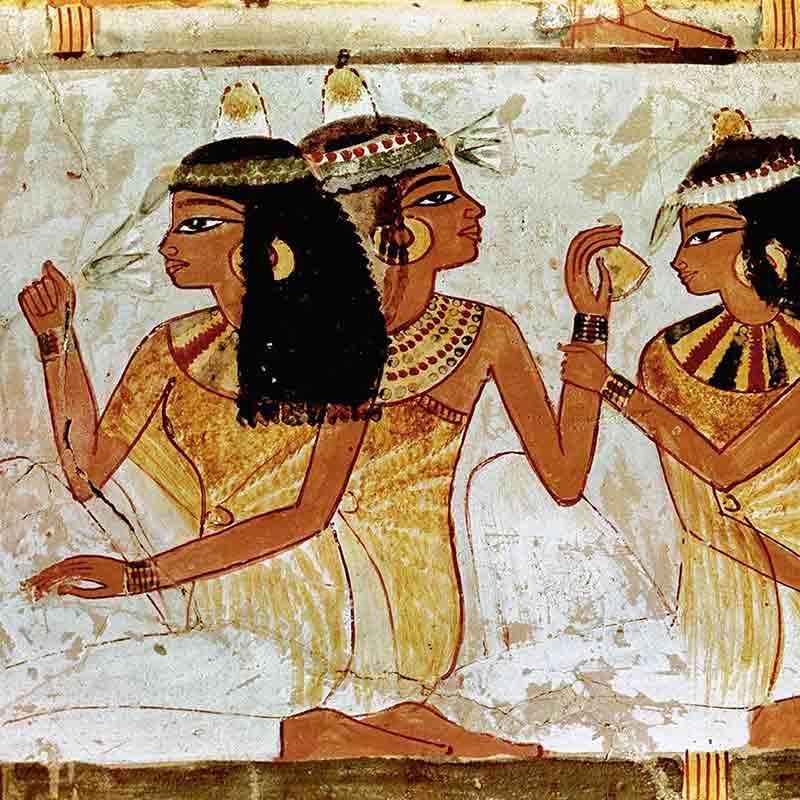 Donne egizie annusano profumi