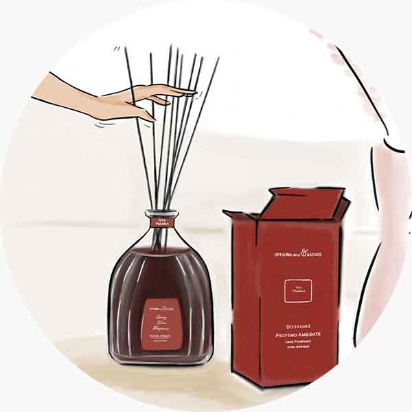 Gently insert the reeds into the glass bottle and open them like a fan